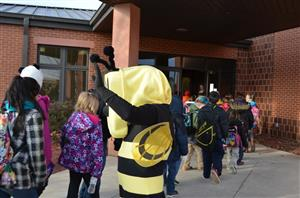 Buzzy greets students